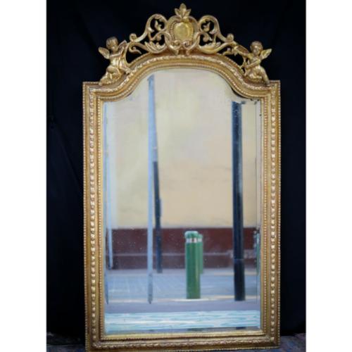 Espejo biselado con marco enmadera dorada con pan de oro
